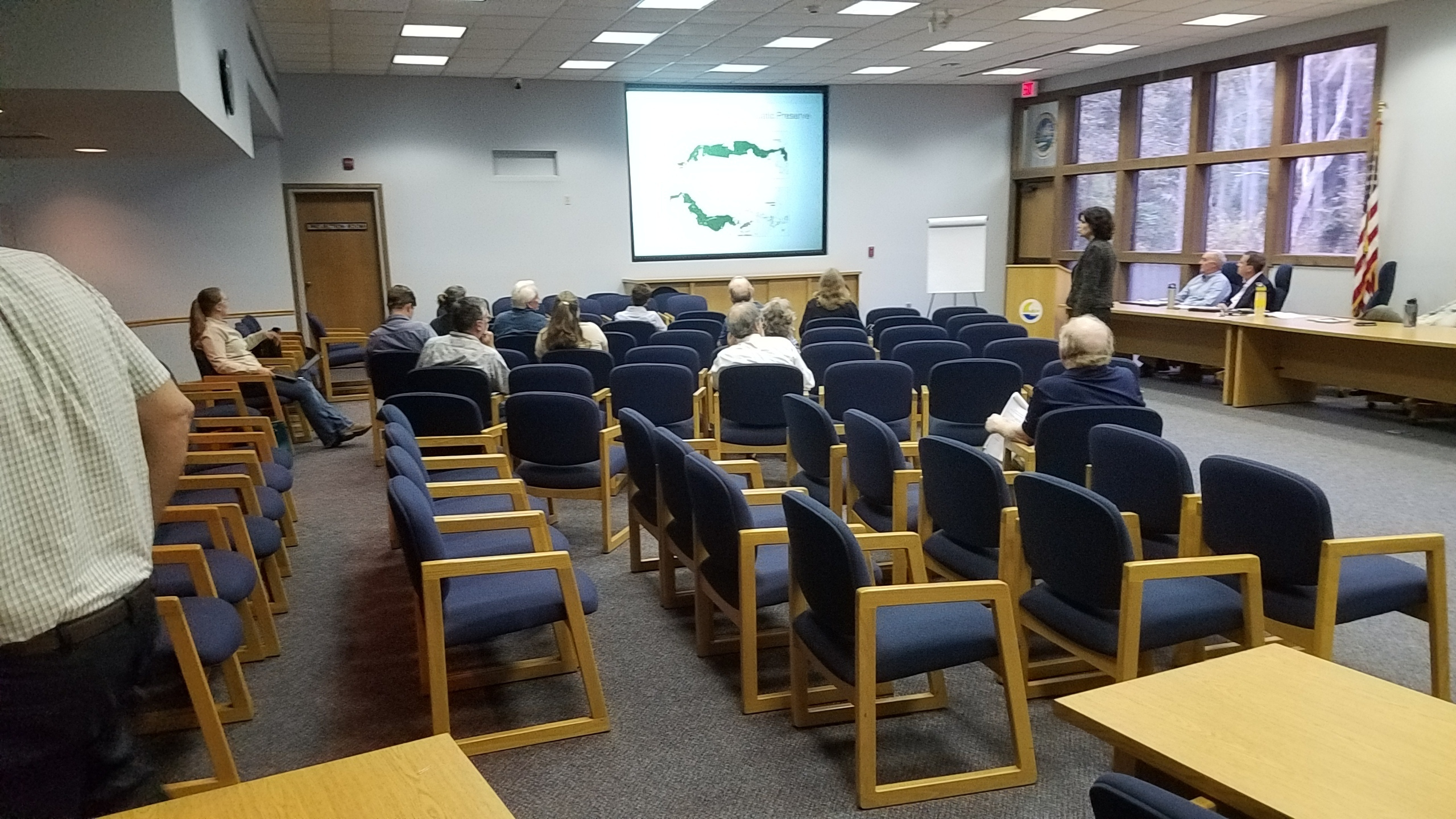 2560x1440 Audience with back of Hugh Thomas, Coastal Rivers Basin Presentation, in SWIM Plan Meeting, Live Oak, by John S. Quarterman, for WWALS.net, 3 October 2017