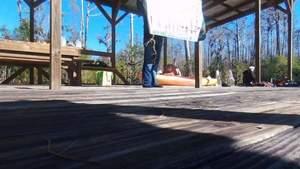 Movie: Gretchen, WWALS banner, platform, Minnie Lake,, Drone 30.8612160, -82.3235180