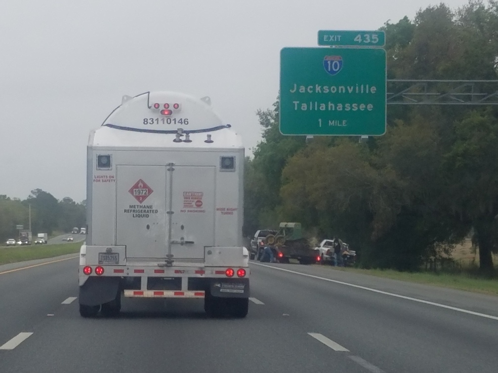 1008x756 1 Mile, I-75 Exit 435 for I-10 Jacksonville Tallahassee, in LNG truck on I-75 and I-10, by John S. Quarterman, for WWALS.net, 26 March 2018