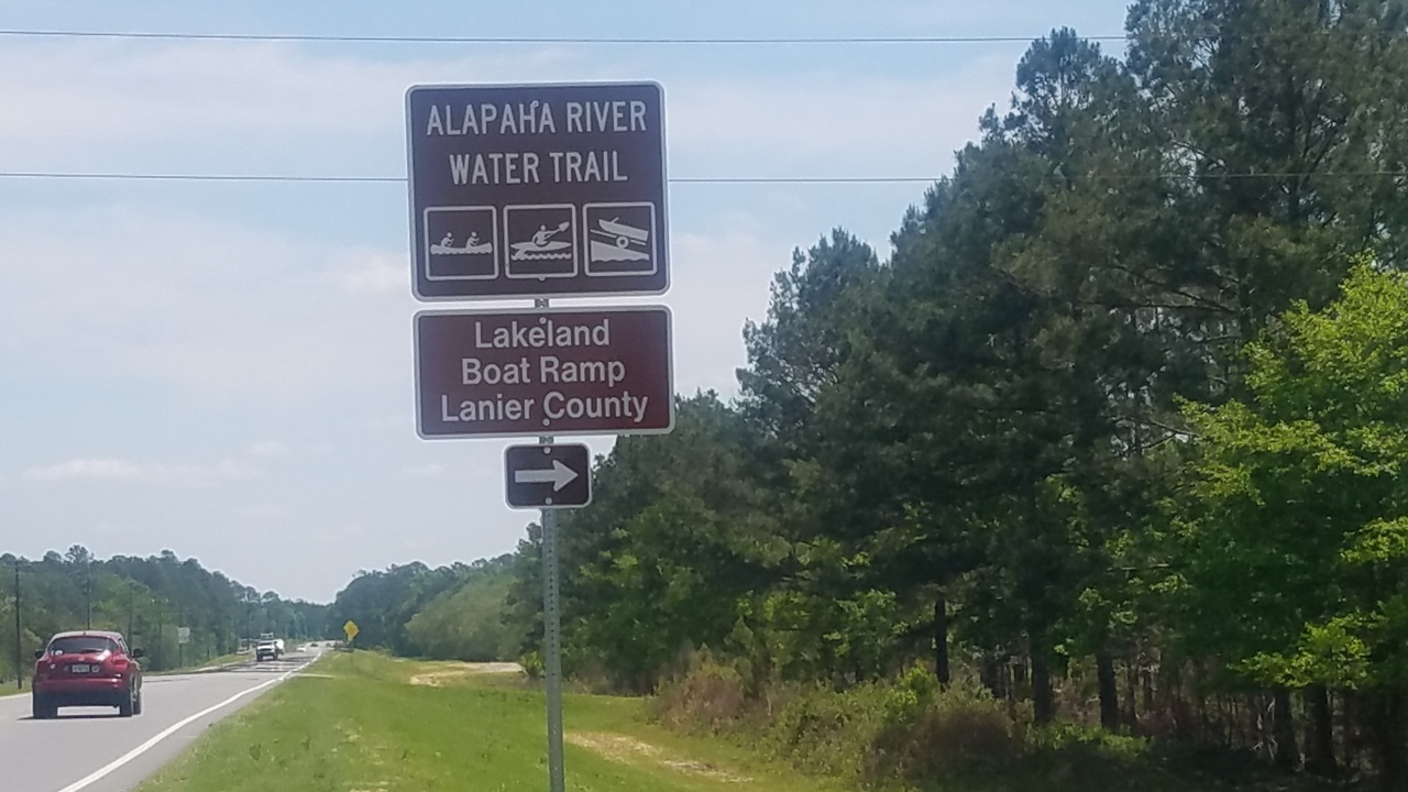 1280x720 Turnoff in sight, Eastbound, in Lakeland Boat Ramp road signs, by John S. Quarterman, for WWALS.net, 26 April 2018