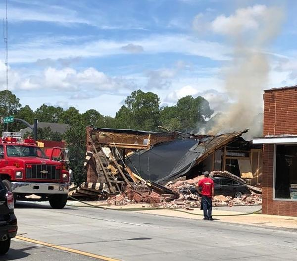 Hosing down remains of Coffee Corner, Clinch County News