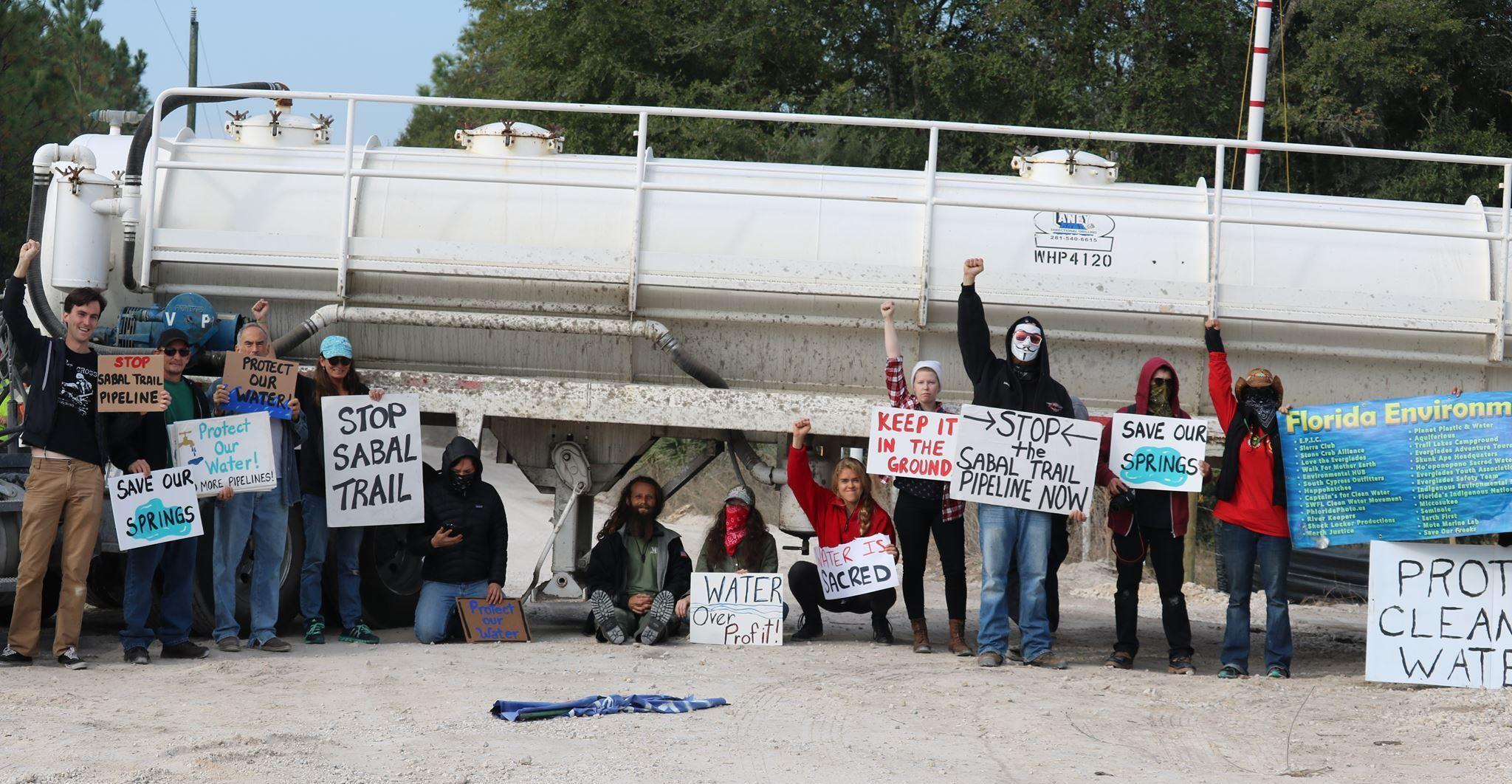 2048x1062 Standing protesters and water truck, in Florida Drops All Charges Against the 14 Gilchrist County Sabal Trail Protesters, by John S. Quarterman, for WWALS.net, 17 July 2017