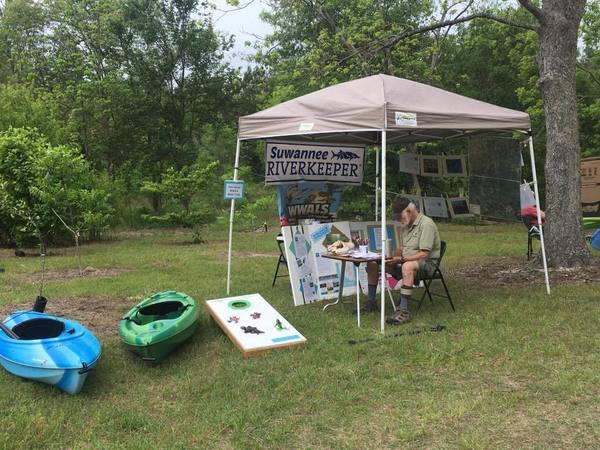 Kayaks and froggy toss game, Booth
